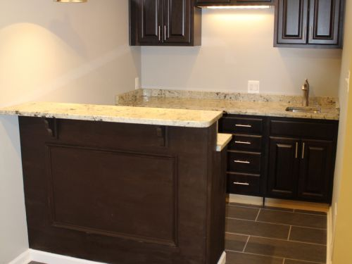 In-home bar area with granite countertops