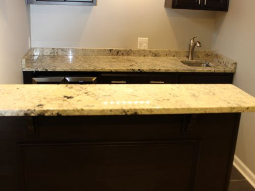 Bar area in home with granite countertops