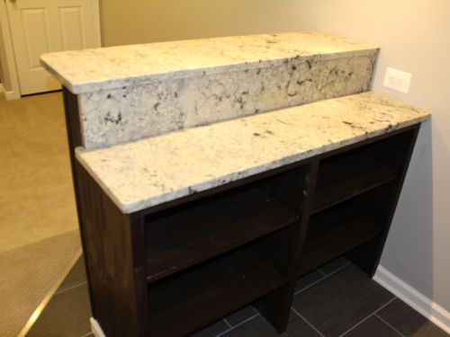 Bar area with granite countertop