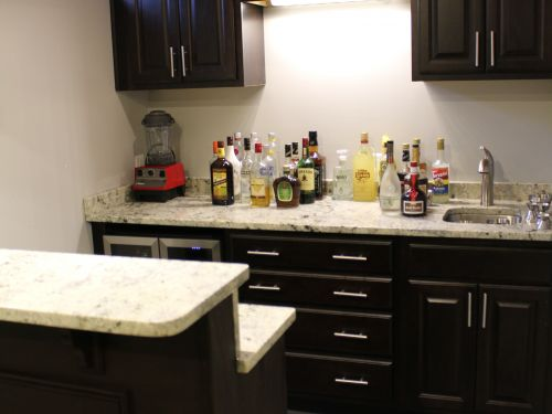 Bar area in home stocked with liquor