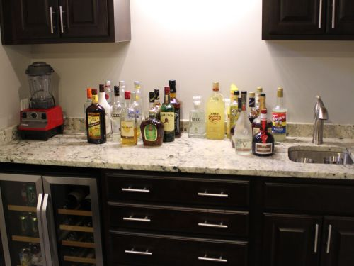 Redesigned kitchen interior with liquor bottles on counter