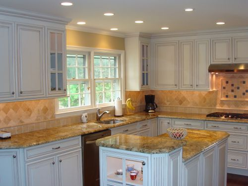 Kitchen remodeling project featuring beige kitchen countertops