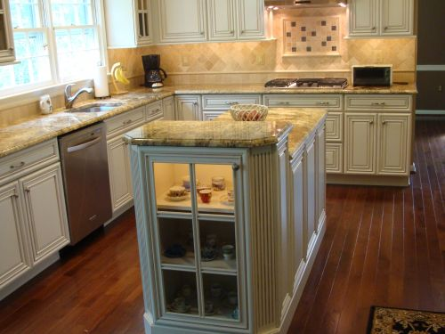 Completed kitchen remodeling project featuring beige granite countertops