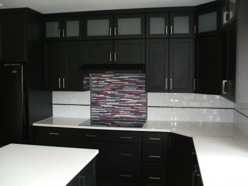Remodeled kitchen with white countertops