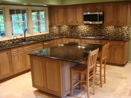 Finished kitchen remodeling project with black countertops