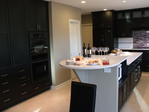 Remodeled kitchen counter top with a bottle of wine and wine glasses